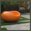 A CA modern garden path with pavers, synthetic turf, modern outdoor furniture, garden balls, and bamboo