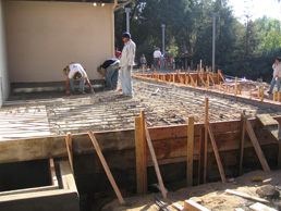 landscape patio being formed during construction with workers installing rebar near Pasadena