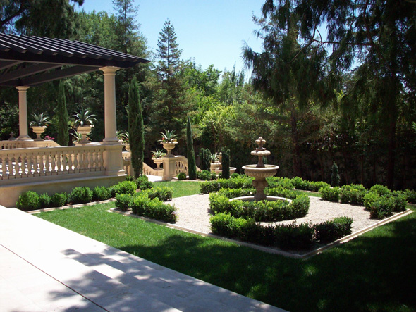 a Formal Italian garden with trellis, fountain, knot garden, patio, balustrades, urns, and boxwood near Pasaden